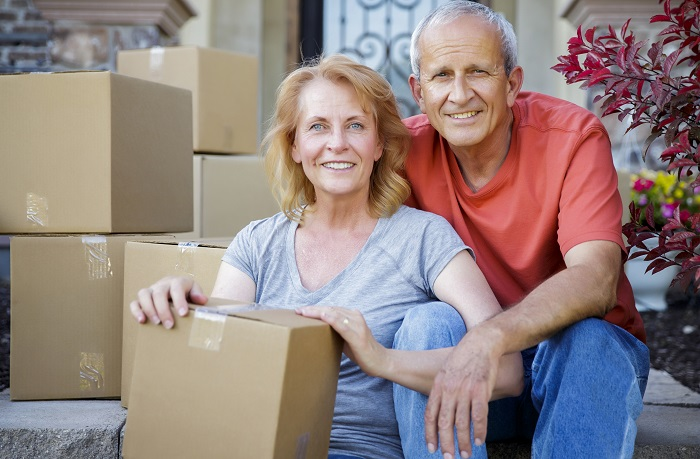Couple with moving boxes image