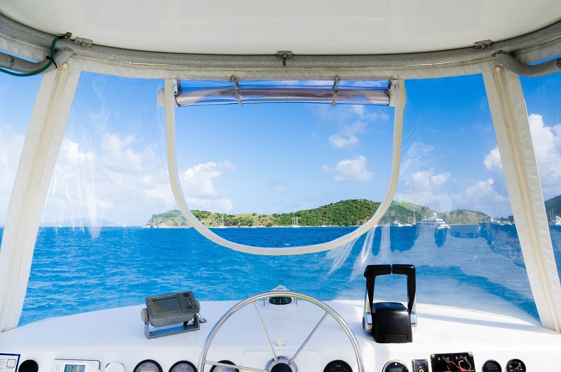View from a motor boat across tropical waters to an island